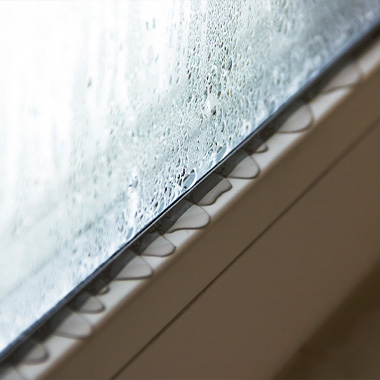 condensations running down glass window and onto the window sill - condensation control